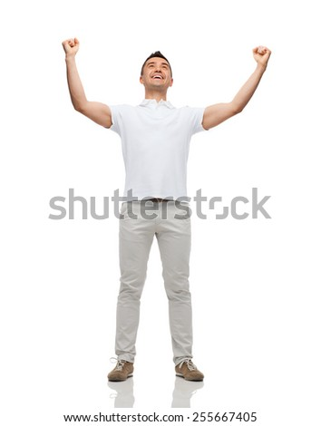 happiness, gesture and people concept - happy man with raised hands - stock photo