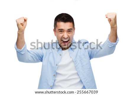 happiness, gesture, emotions and people concept - happy laughing man with raised hands - stock photo