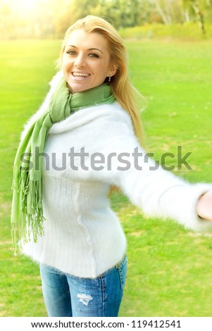 Happiness girl with open hands enjoyment nature at beautiful sunny day. - stock photo