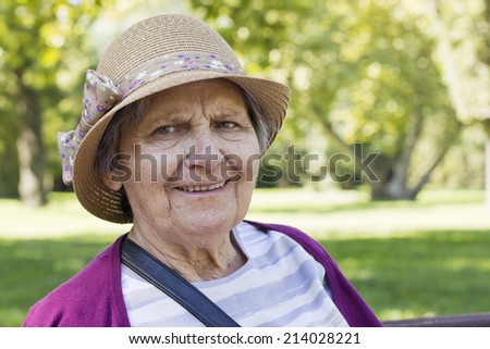 Happiness grandmother portrait outdoors. - stock photo