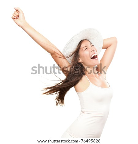 Happiness. Happy summer woman isolated in studio. Energetic fresh portrait of young woman excited cheering in wearing beach hat. Beautiful mixed race Asian Caucasian model isolated on white background - stock photo