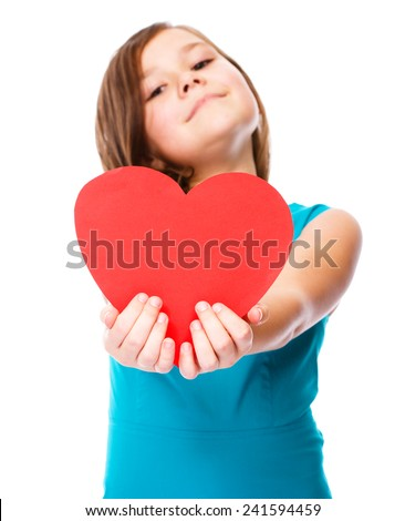 Happiness, health and love concept - smiling girl with red heart, isolated over white