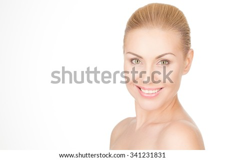 Happiness is the main beauty secret. Gorgeous mature female smiling happily isolated on white background - stock photo