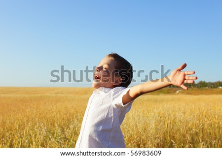 Happiness little child relaxing outdoors - stock photo
