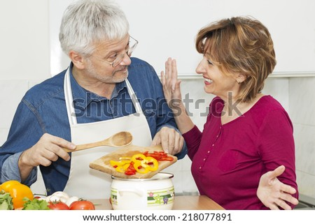 Happiness mature couple in the kitchen. - stock photo