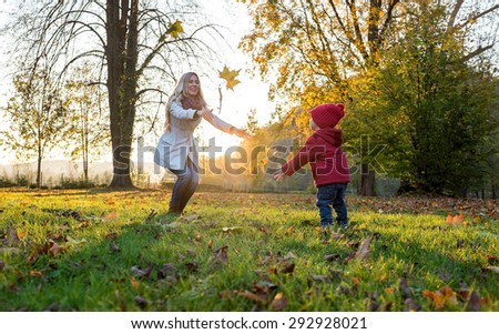 Happiness mother and son in autumn