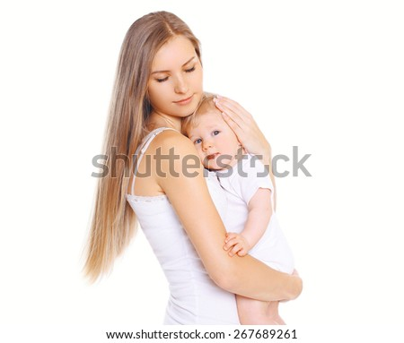 Happiness mother! Beautiful young loving mom hugs her cute baby - stock photo