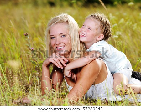 Happiness of the  mother and daughter - people on nature