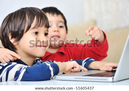 Happiness on laptop games - stock photo
