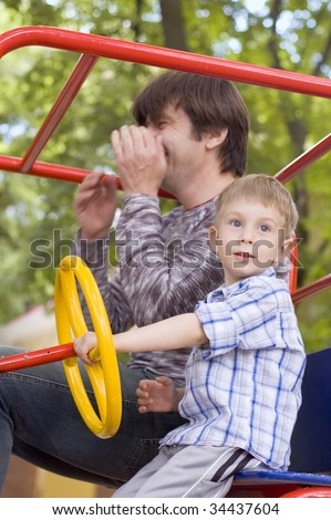 happiness on playground - father play with his little son