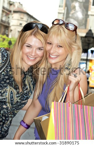 Happiness  shopping woman's  with  bags in city environment.