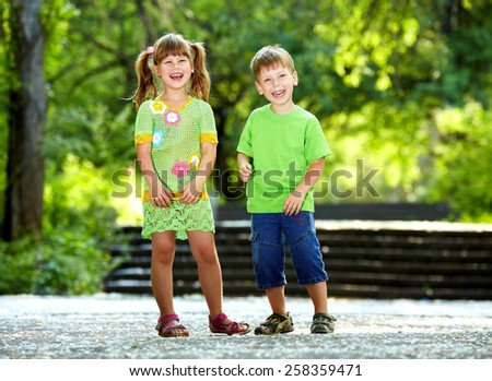 Happiness smiling boy and girl fun outdoor under sunlight - stock photo