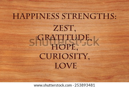Happiness strengths - zest, gratitude, hope, curiosity, love - list of character strengths for recipe of happiness - on wooden background - stock photo