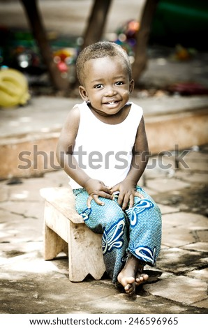 Happiness Symbol: Handsome Little African Boy Smiling Happily Expressing Positivity - stock photo