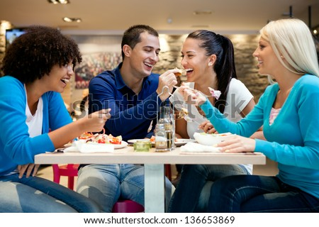 Happiness teenagers enjoying in lunch at restaurant - stock photo