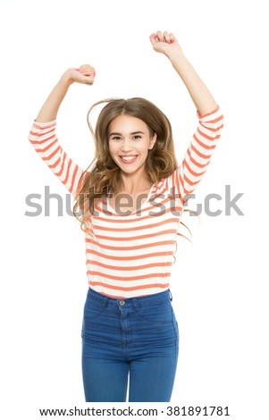 Happiness. Waist up portrait of a young beautiful brunette girl wearing a white red frock jumping and smiling happily holding hand above her head, isolated on white background - stock photo