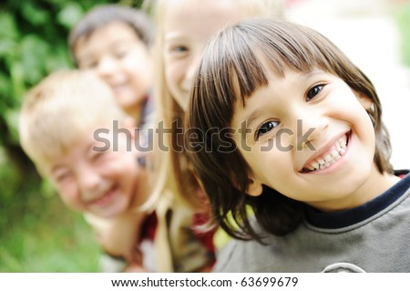 Happiness without limit, happy children together outdoor, faces, smiling and careless - stock photo