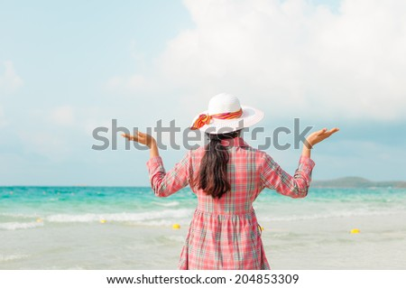 Happiness woman at the beach - stock photo