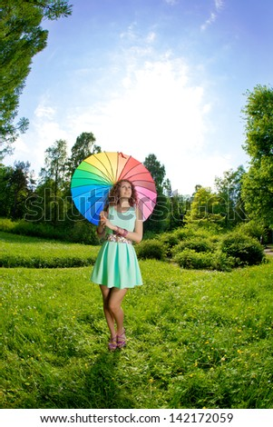 Happiness young beauty woman with rainbow umbrella - stock photo