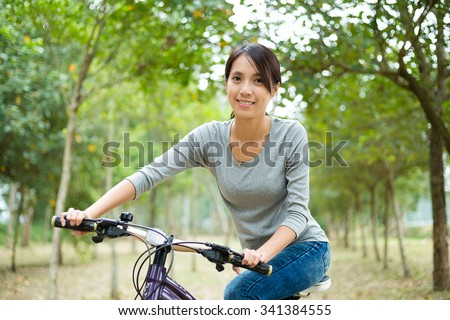 Happt woman enjoy cycling - stock photo