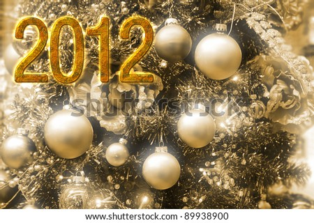 Happy 2012 a festive decoration for a happy new year in white, gold and beige - stock photo