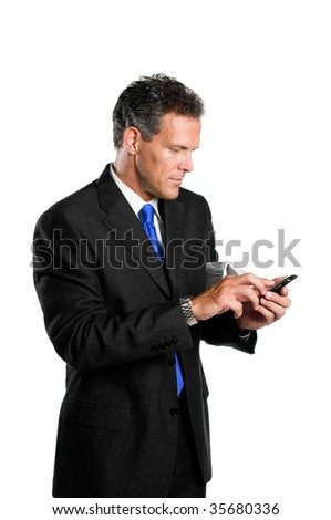 Happy absorbed mature businessman looking and dialing at his palmtop isolated on white background - stock photo