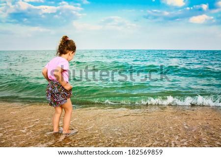 Happy Active Child Girl Having Fun On Beautiful Beach. Child Running On Water At Ocean Beach. - stock photo