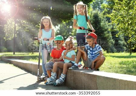 Happy active children in park - stock photo