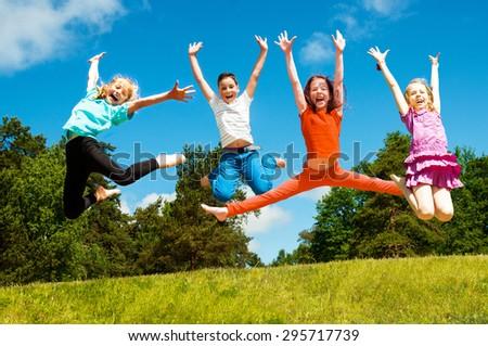 Happy active children jumping - stock photo