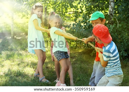 Happy active children playing in park - stock photo