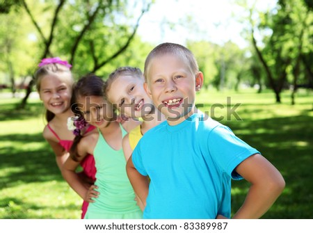 Happy active children playing in the summer park