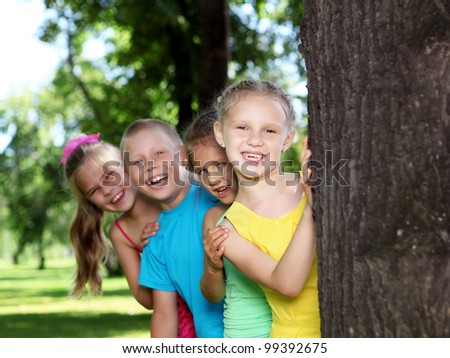 Happy active children playing in the summer park - stock photo