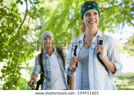 Happy active couple going on a hike on a sunny day - stock photo