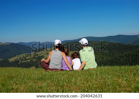 Happy active family having fun on summer vacation in mountains