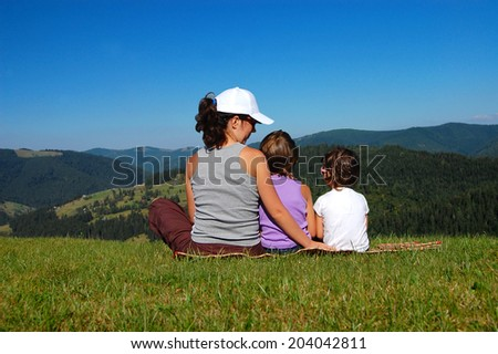 Happy active family having fun on summer vacation in mountains - stock photo