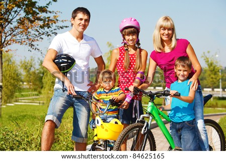 Happy active parents and their three kids - stock photo