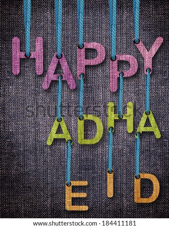 Happy Adha Eid Letters hanging strings with blue sackcloth background. - stock photo