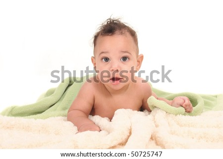 Happy Adorable Baby Boy Lying on His Tummy With Blankets - stock photo