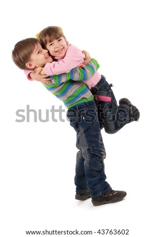 Happy adorable kids hugging each other
