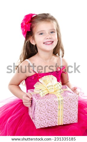Happy adorable little girl with christmas gift box in princess dress isolated on a white background