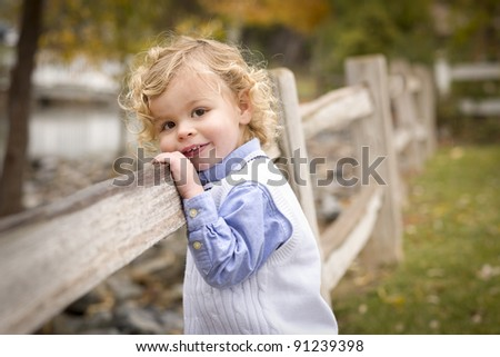 Happy Adorable Young Blonde Boy Playing Outside. - stock photo