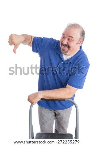 Happy Adult Bearded Man in Blue Polo Shirt, Leaning Against a Chair While Showing Thumbs Down Sign to Someone. Isolated on White. - stock photo