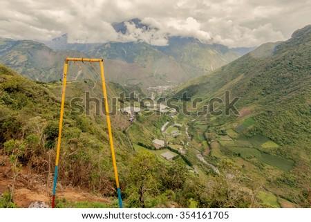 Happy Adult Caucasian Man Swinging On A Swing, called Flight Of The Condor, Banos De Agua Santa, Ecuador - stock photo