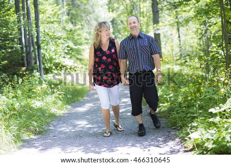 Happy adult couple in park