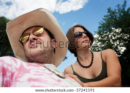 Happy Adult Couple Outside on Cloudy Day - stock photo