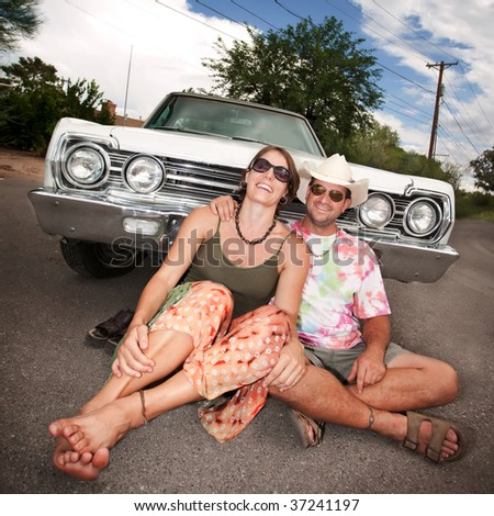 Happy Adult Couple with Vintage White Car - stock photo