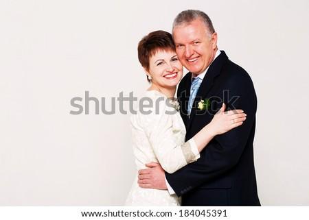 happy adult married couple in studio - stock photo