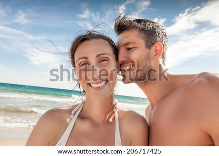 happy adult on seaside with blue sky - stock photo