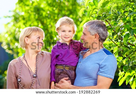 happy adult parents with small son