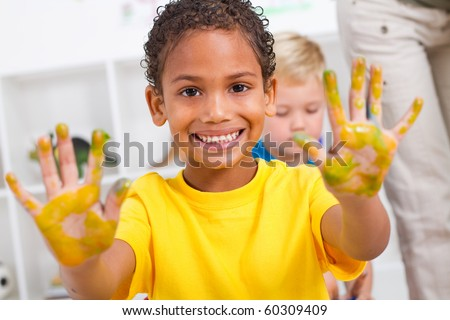 happy african american boy with hand paint - stock photo
